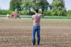 Farmer with hoe Stock Image