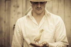 Farmer Holding a Baby Turkey Royalty Free Stock Photos