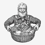 Farmer holding a basket of vegetables. Natural, organic food Stock Photos