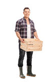 Farmer holding an empty wooden crate Royalty Free Stock Photos