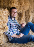 Farmer  holding phone at shed Royalty Free Stock Photography