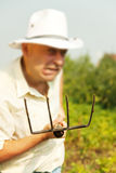 Farmer holding pitchfork Stock Images