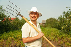 Farmer holding pitchfork Royalty Free Stock Photography
