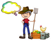 A farmer holding a rake with an empty callout Royalty Free Stock Image
