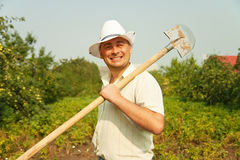 Farmer holding  spade Royalty Free Stock Image