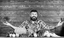 Farmer with homegrown vegetables. Vegetables organic harvest. Farmer rustic style guy. Vegetarian lifestyle concept. Natural foods. Man bearded farmer harvest stock photos