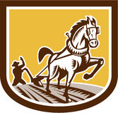 Farmer and Horse Plow Farm Crest Woodcut Retro. Illustration of farmer and horse plowing farm field viewed from front set inside crest shield shape done in retro Stock Photo