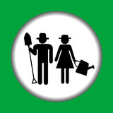 Farmer icon with farmers man and woman Stock Photos