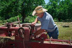 Farmer inspects Equipment Stock Photos
