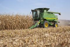 Farmer in a John Deere combine harvesting corn. WEST ALBANY, MINNESOTA, USA - October 12, 2010: A farmer harvests corn in a John Deere combine. John Deere is a Stock Images
