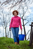 Farmer lady with a bucket Stock Photography
