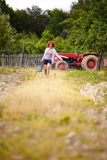 Farmer lady with a bucket in an orchard Royalty Free Stock Photos