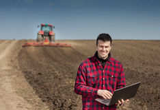 Farmer with laptop on the farmland Royalty Free Stock Photography