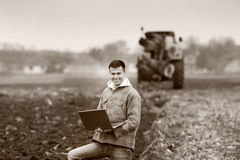 Farmer with laptop in field Royalty Free Stock Images