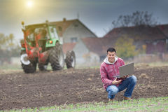 Farmer with laptop Stock Images