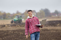 Farmer with laptop Royalty Free Stock Photography