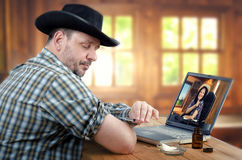Farmer learning to give intramuscular self-injection with country doctor online Stock Photo