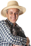 Farmer with a little black piggy Royalty Free Stock Photo