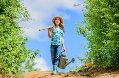 Farmer little girl. garden tools, shovel and watering can. kid worker sunny outdoor. family bonding. spring country side stock images