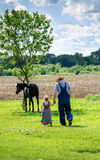 Farmer and little girl walking Royalty Free Stock Photos