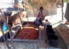 Farmer making brown sugar (jaggery) in rural india. A farmer making brown sugar, also called as jaggery, in rural area of ashoknagar district, Madhya Pradesh Royalty Free Stock Photo