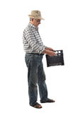 A farmer man carries a plastic box Royalty Free Stock Photo