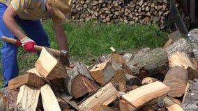 Farmer man chop wood in backyard. 4K stock video