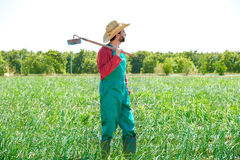 Farmer man with hoe looking at his field Stock Photos