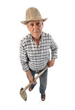 Farmer man with a hoe Stock Images