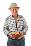 A farmer man holds a bowl with eggs Royalty Free Stock Photos