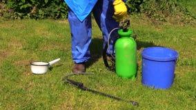 Farmer man prepare pesticides chemicals for plant spray stock footage