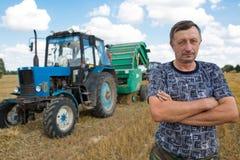 Farmer man standing in field Royalty Free Stock Photo