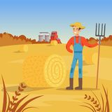 Farmer man standing with pitchfork near of hay bale, agriculture and farming  Stock Photos