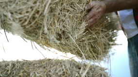 Farmer man with straw bales stock footage
