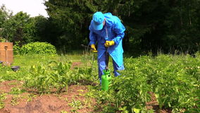 Farmer man in waterproof clothes prepare pesticides chemicals Royalty Free Stock Images