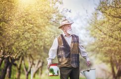 Farmer with milk bottles Royalty Free Stock Images