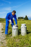 Farmer with milk containers Stock Images