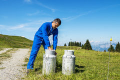 Farmer with milk containers Royalty Free Stock Image