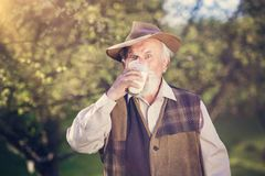 Farmer with milk jug Royalty Free Stock Photography