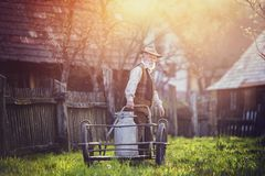 Farmer with milk kettle Royalty Free Stock Photo
