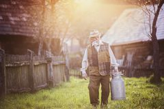 Farmer with milk kettle Royalty Free Stock Images