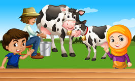 Farmer milking a cow Royalty Free Stock Image