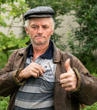 The farmer with money in his jacket Royalty Free Stock Images