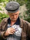 The farmer with money in his jacket Stock Images
