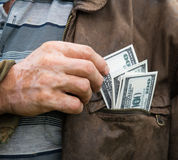 The farmer with money in his pocket Royalty Free Stock Photos