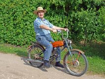 Farmer on moped 2. Senior country farmer driving old homemade moped Stock Photo