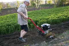 The farmer with a motor-cultivator Royalty Free Stock Photography