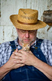 Farmer with new kitten Royalty Free Stock Photo