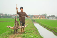 A farmer in the north of vietnam is going to work on his paddy field Royalty Free Stock Images