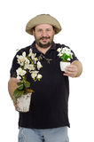 Farmer offers you to buy two flower pots. Bearded smiling farmer offers you to buy two white flower pots Stock Images